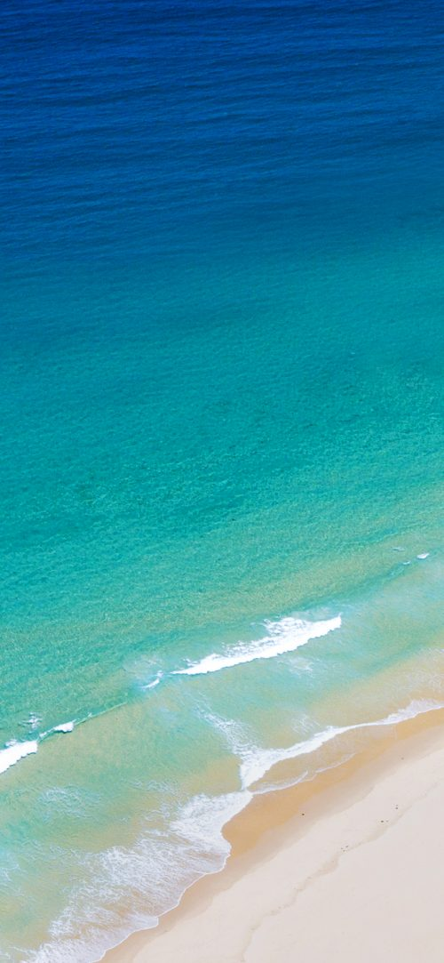 Beach Wallpaper for Phone with Blue Wave in Close Up